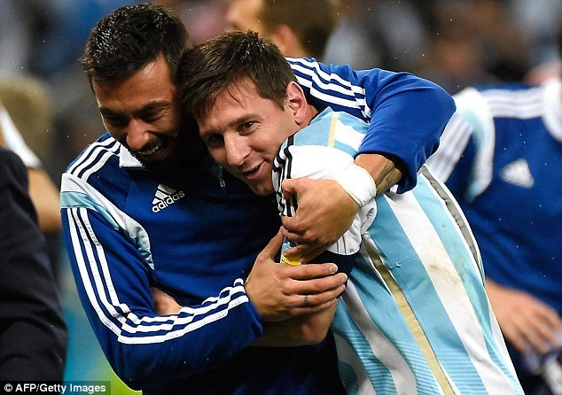 Garay with Messi