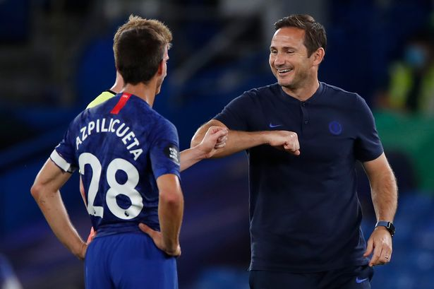 Lampard shaking hands with former Chelsea man De Bruyne.